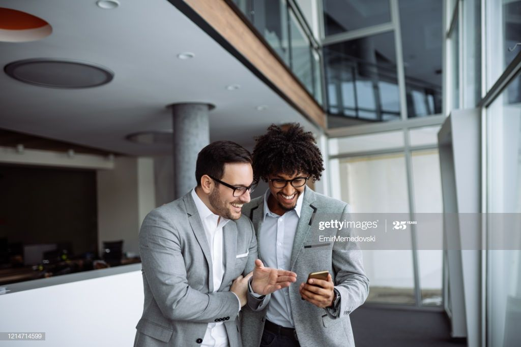 Diverse Male Employees Standing In Hallway Using Smart Phone Photography #Ad, , #Ad, #Employees, #Standing, #Diverse, #Male
