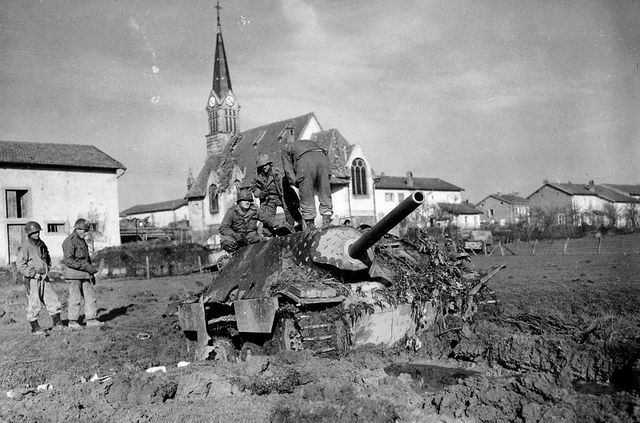 US troops examine a destroyed German StuGG.
