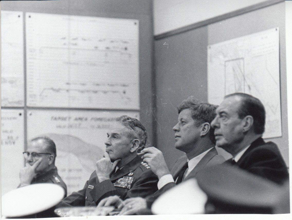 jfk with joint chiefs with map of cuba in background during cuban missile crisis