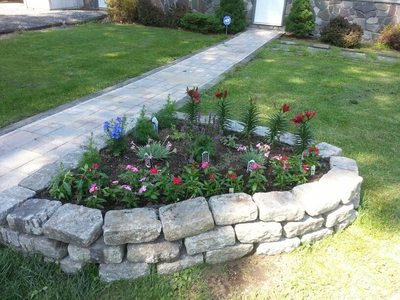 Great & simple idea for a flower bed. We used old pavers