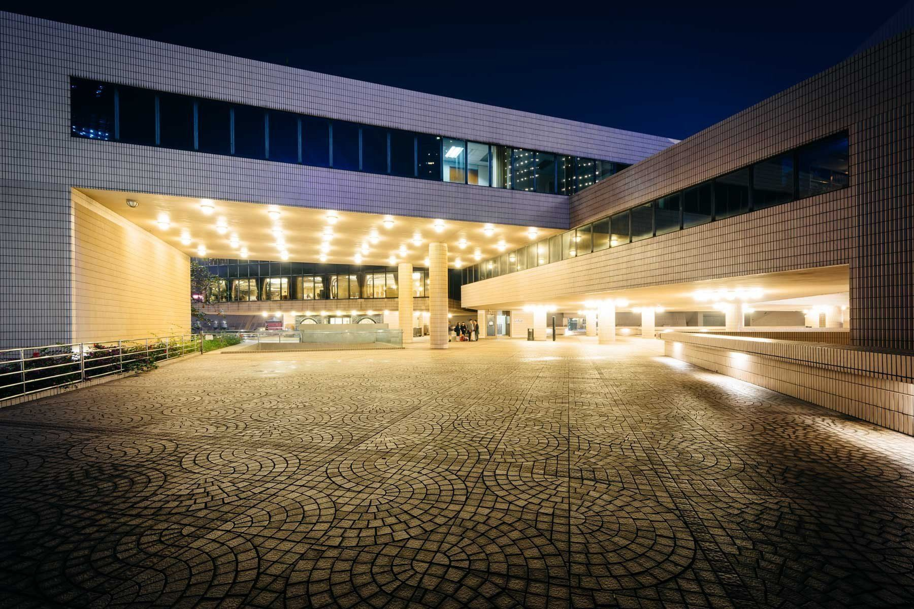 The exterior of the Hong Kong Cultural Centre at night, in Kowloon ...