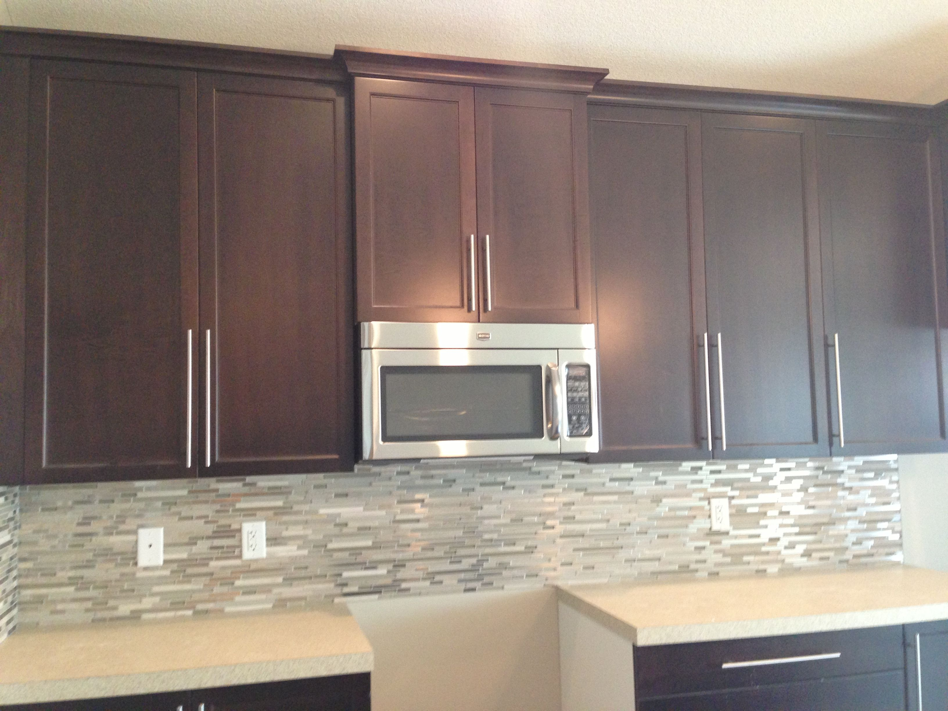 48 Inch Upper Cabinets With Clay Titanium Mosaic Tile Backsplash.
