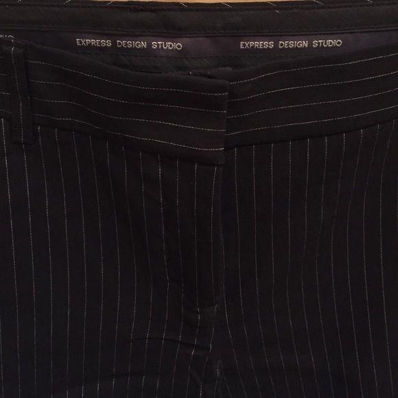 Express pinstripe pants Black pinstripe pants from the Express Design studio collection. Size 8 short. Only worn a few times. Excellent condition. Editor style. Express Pants Boot Cut & Flare