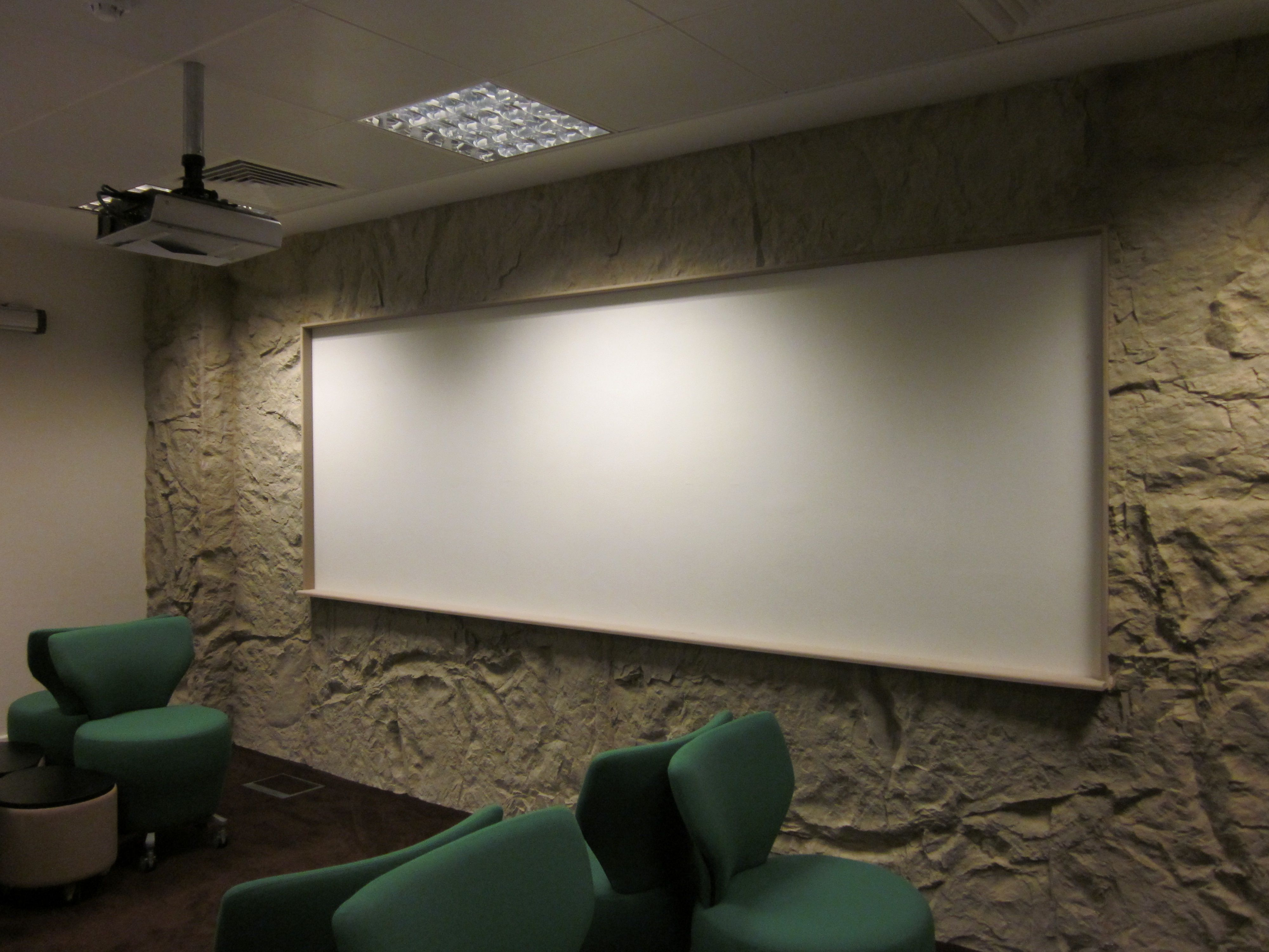 Fiberglass Rock wall design with write on paint, installed into meeting room.