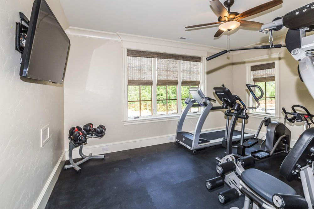 Traditional Home Gym with High ceiling, Carpet, Crown ...