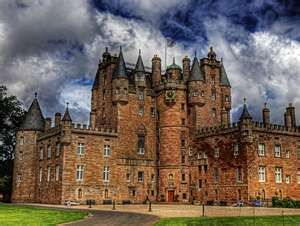 Glamis Castle  in Scotland, where Queen Elizabeth (the Queen Mum) lived as a girl.  Haunted by Lady Janet Douglass, who met a sad fate there.