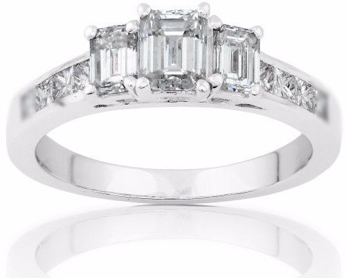 IGI Certified Emerald Cut Single Halo Engagement Ring Center Stone Carat Weight: 0.51 carat One 18k white gold ring, stamped 18k Diamonds: 2 Emerald wt 0.50 ct, color: H-I Clarity: SI1-SI2 0.62 ct Col