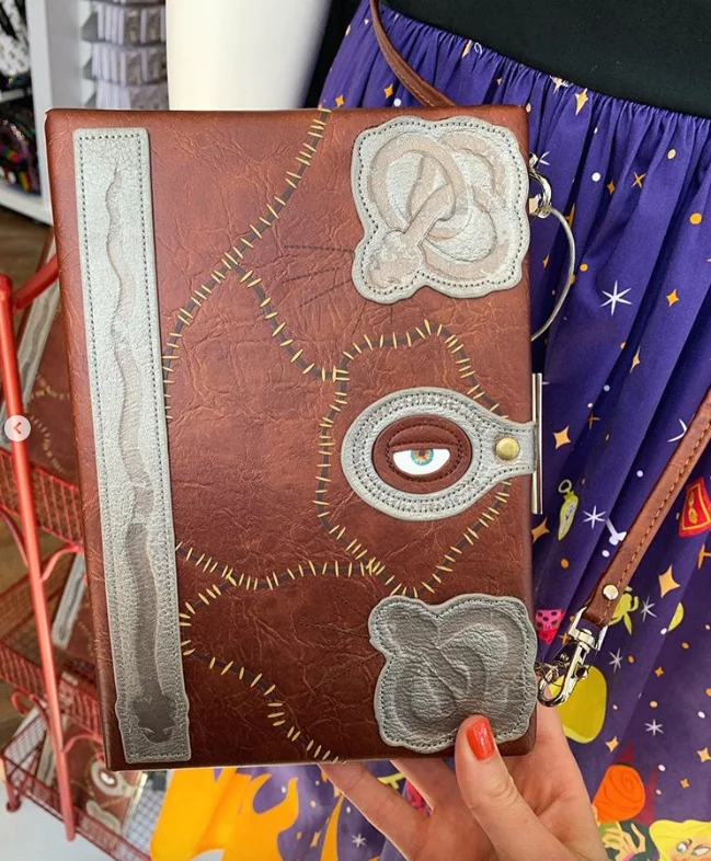Disney Is Selling A Hocus Pocus Spell Book Clutch And We Need To Form A Calming Circle Book Clutch Hocus Pocus Spell Book Hocus Pocus Spell