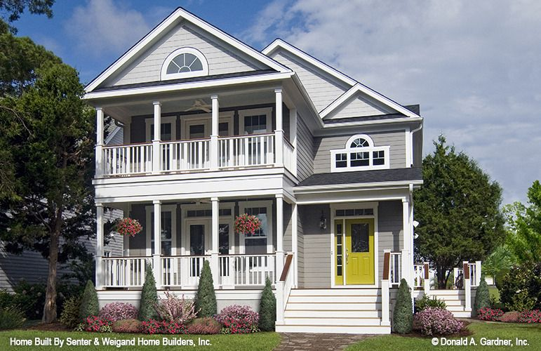 This Narrow Lot Home Plan Has A Surprisingly Stylish Facade With First And Second Level Porche With Images Colonial House Plans Charleston House Plans Country House Design
