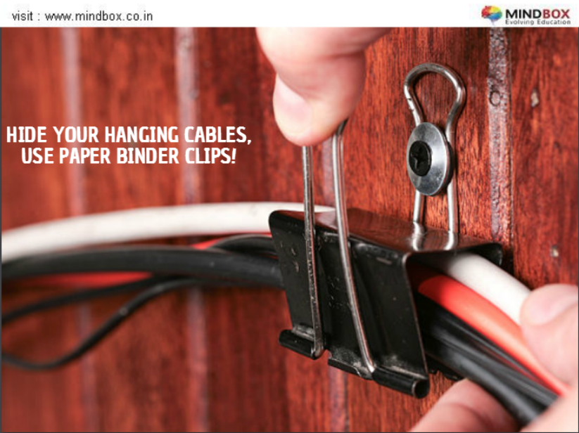 Keep loose hanging wires off the floor and out of sight by attaching a couple of paper binder clips to the back of your desk or walls! #DIY #MINDBOX