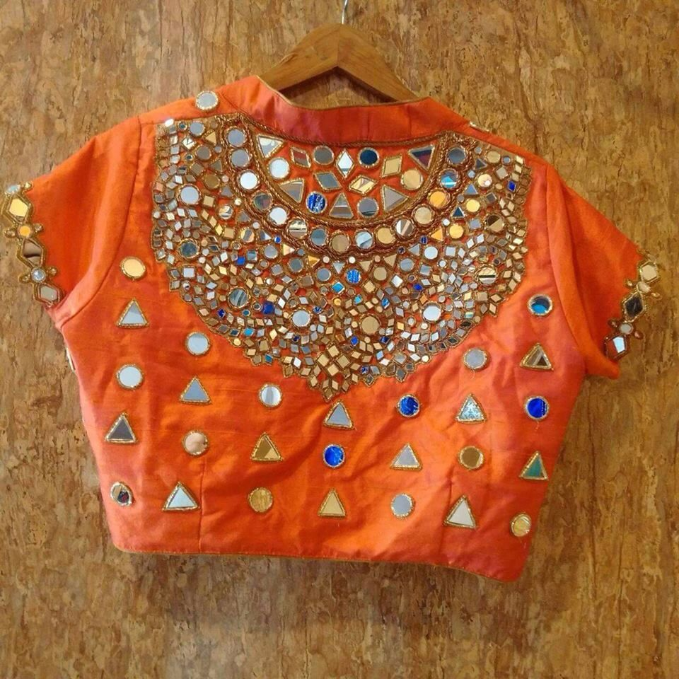 Lehenga blouse design in golden color and mirror work - Orange Saree Blouse With Mirror Work Indian Fashion