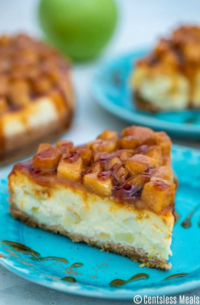 This Caramel Apple Cheesecake dessert is thick, creamy and full of apples. It is very decadent and perfect for holidays like Thanksgiving! Every bite is pure indulgence! #centslessmeals #caramelapplecheesecake #cheesecakerecipe #caramelrecipe #homemadecheesecake #bakedcheesecake #applepiecheesecake #caramelcheesecake #applerecipe #caramelapplecheesecake This Caramel Apple Cheesecake dessert is thick, creamy and full of apples. It is very decadent and perfect for holidays like Thanksgiving! Every #caramelapplecheesecake