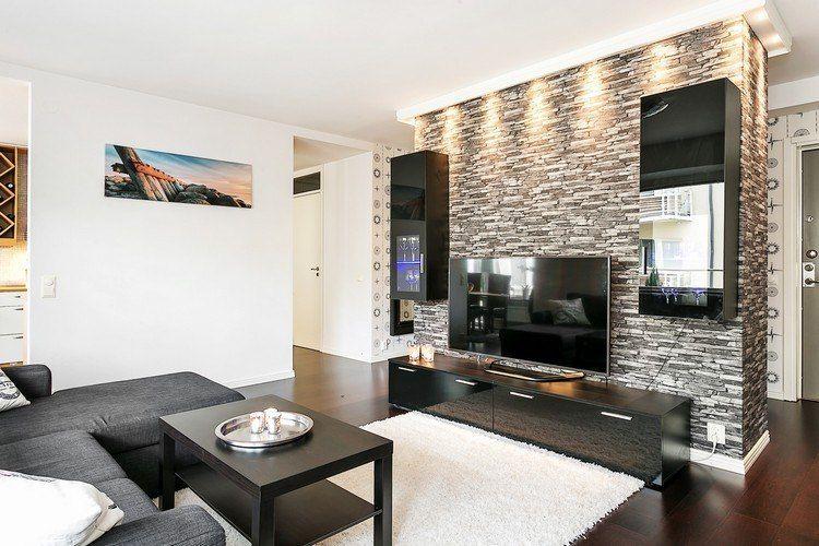 Durch beleuchtung akzente im wohnzimmer setzen wohnzimmerdekoration pinterest wohnzimmer - Wohnwand steinoptik ...