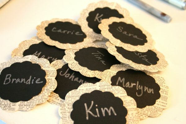 Handmade name tags from an old dictionary, black cardstock, using a template die cut from Spellbinders.   Today's Creative Blog