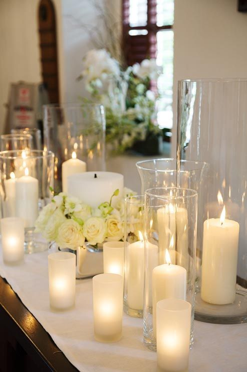 Decorations Tips Glowing Pillar Candles In Hurricane Vases Surround A Larger Central Candle Bulk For Wedding Centerpieces Ideas