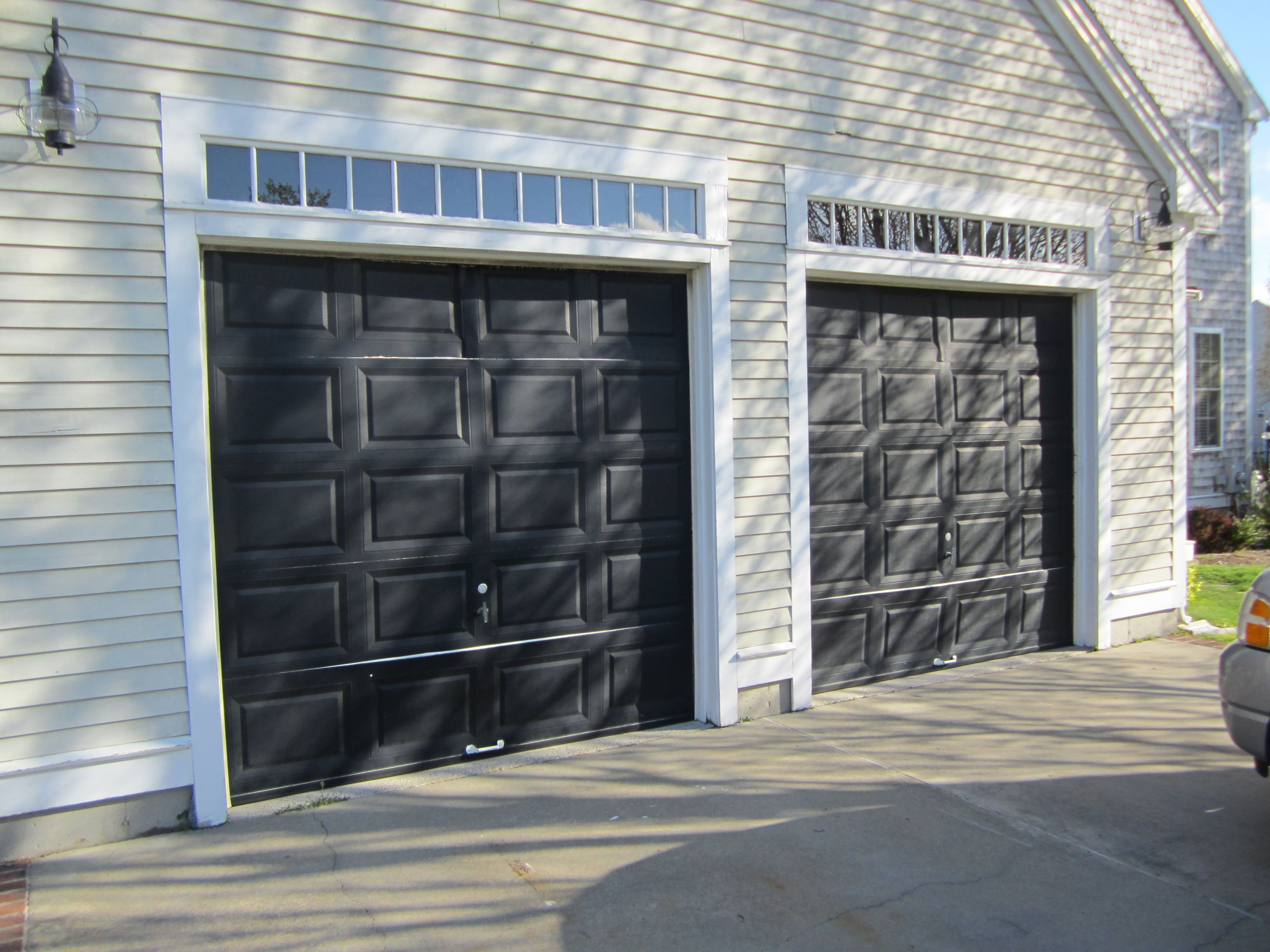 Haas Model 680 Steel Raised Panel Garage Doors In Black Installed