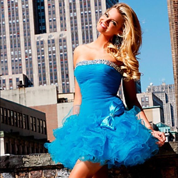 New Sherri Hill minidress turquoise/silver Size 2 Short Ruched Dress With Ruffled Skirt by Sherri Hill This short party dress will capture the essence of your mood. This strapless dress features a straight-cut neckline trimmed in crystals. The ruched bodice is form-fitting and has a moderately-cut back. A skirt of ruffles and a large bow add an element of fun to this vibrant dress. Velocity Fashion (949)302-3355  we only sell 100% authentic dresses Sherri Hill Dresses Mini