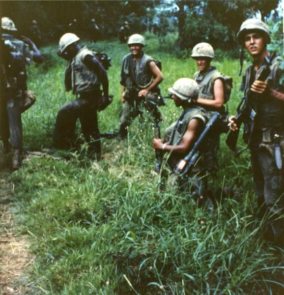 Marines standing on line in the jungles of Vietnam