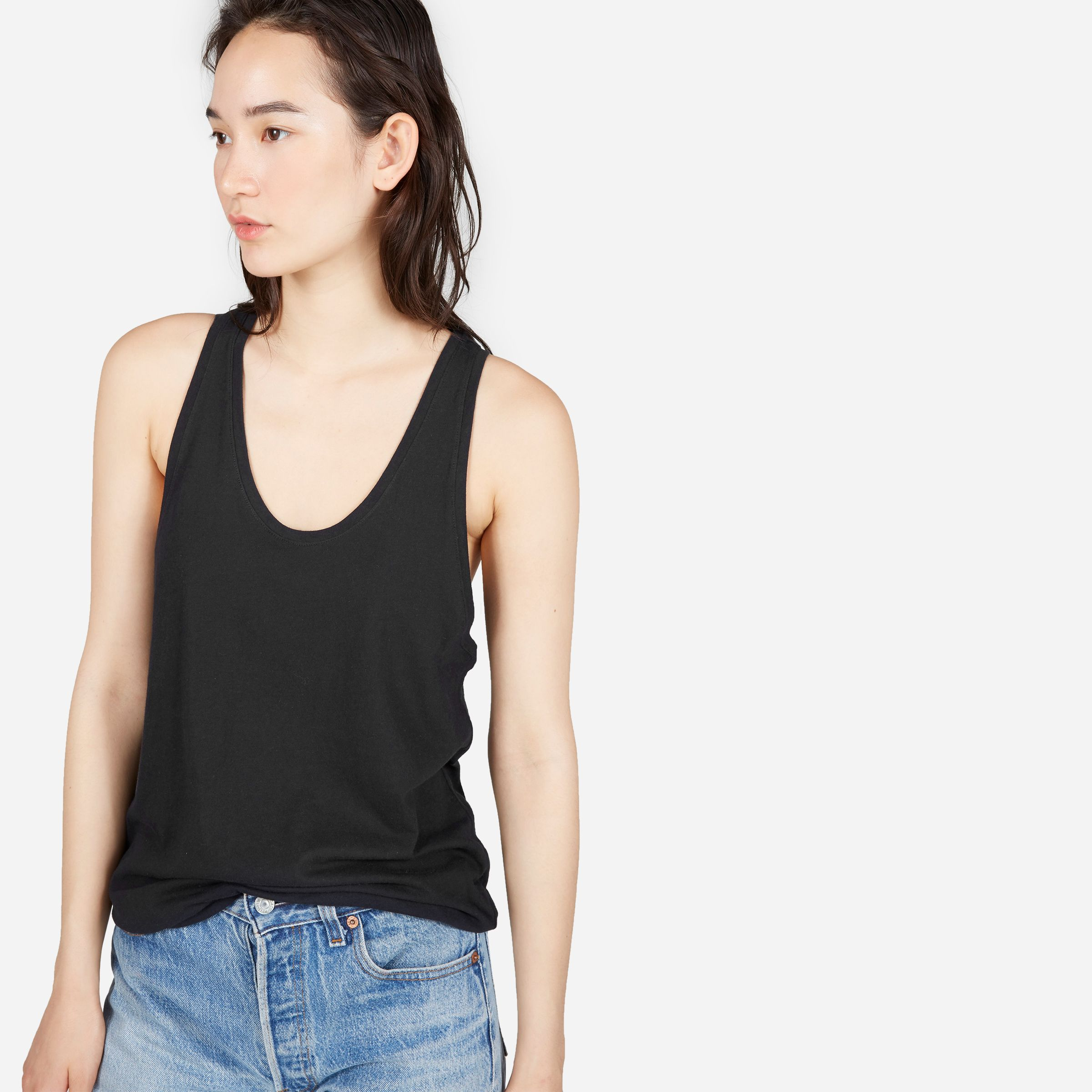 Lightweight and layerable. This cotton racerback tank has generously cut armholes, so you can stay cool on the warmest days. Just pair with your favorite bralette.