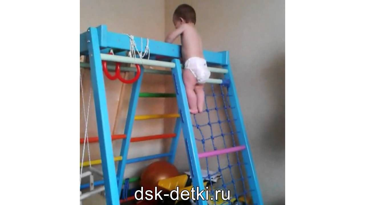 Little buddy climbes the rope wall playground for home sport for