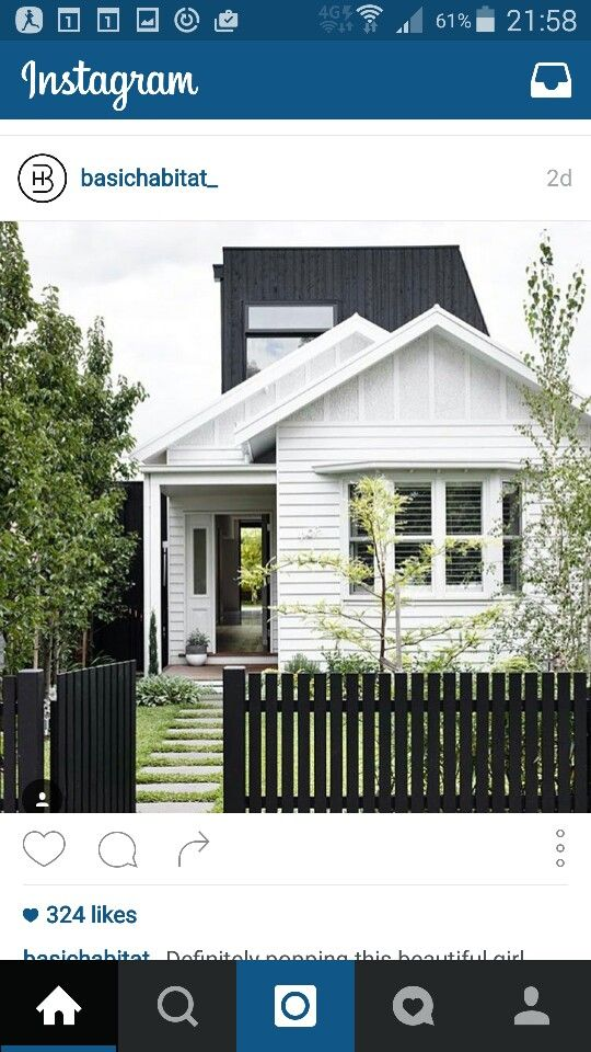Look, feel and colour of this weather board house with black fence ...