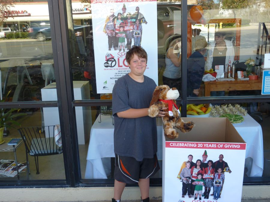 One of our young members making a donation.