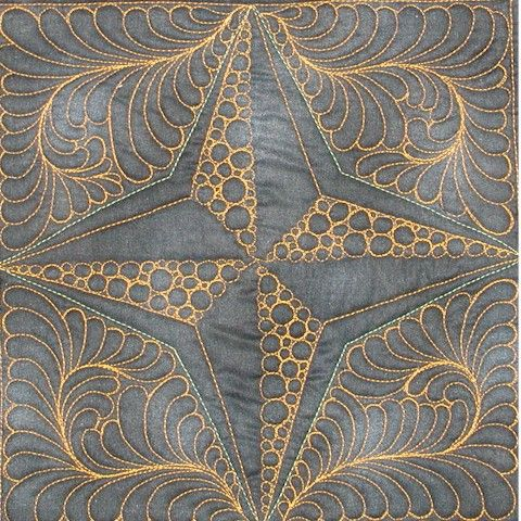 the back of the Starry Pursuit quilt block . . . one heck of a machine quilter. Kudos!