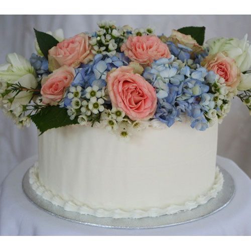 For a quick and easy decorated cake, use fresh flowers and a CakeVase. Start with a homemade or store-bought iced cake, press the plastic vase firmly into frosting, add water, arrange flowers and you have a stunning cake in minutes! Keeps flowers and greenery fresh and safely away from the cake. It's an affordable alternative to custom cakes for birthdays, graduations, showers and more. Set includes 3 topper reusable vases that work with 6, 8 or sheet cakes - use with fresh or silk flowers…