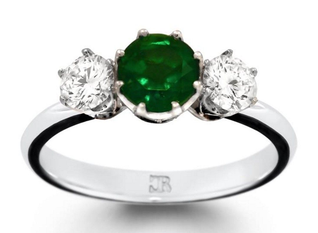 Round cut emerald is set with a pair of brilliant cut diamonds, in this fully hand made 18 carat white gold setting.