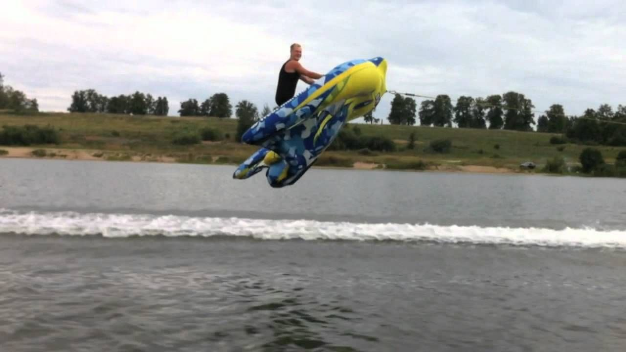 Guy Lifts Off Into The Air  Flies Over Water On An Inflatable Kite Tube  Laughing Squid  Kite -3887