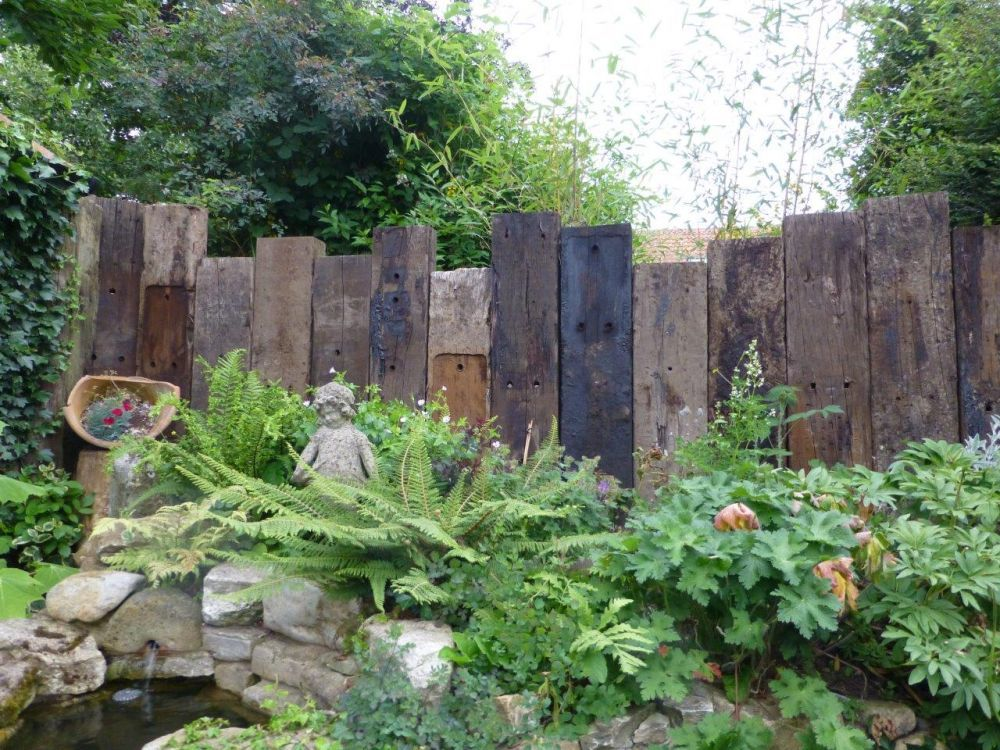 North Nottingham wall from vertical used railway sleepers ...