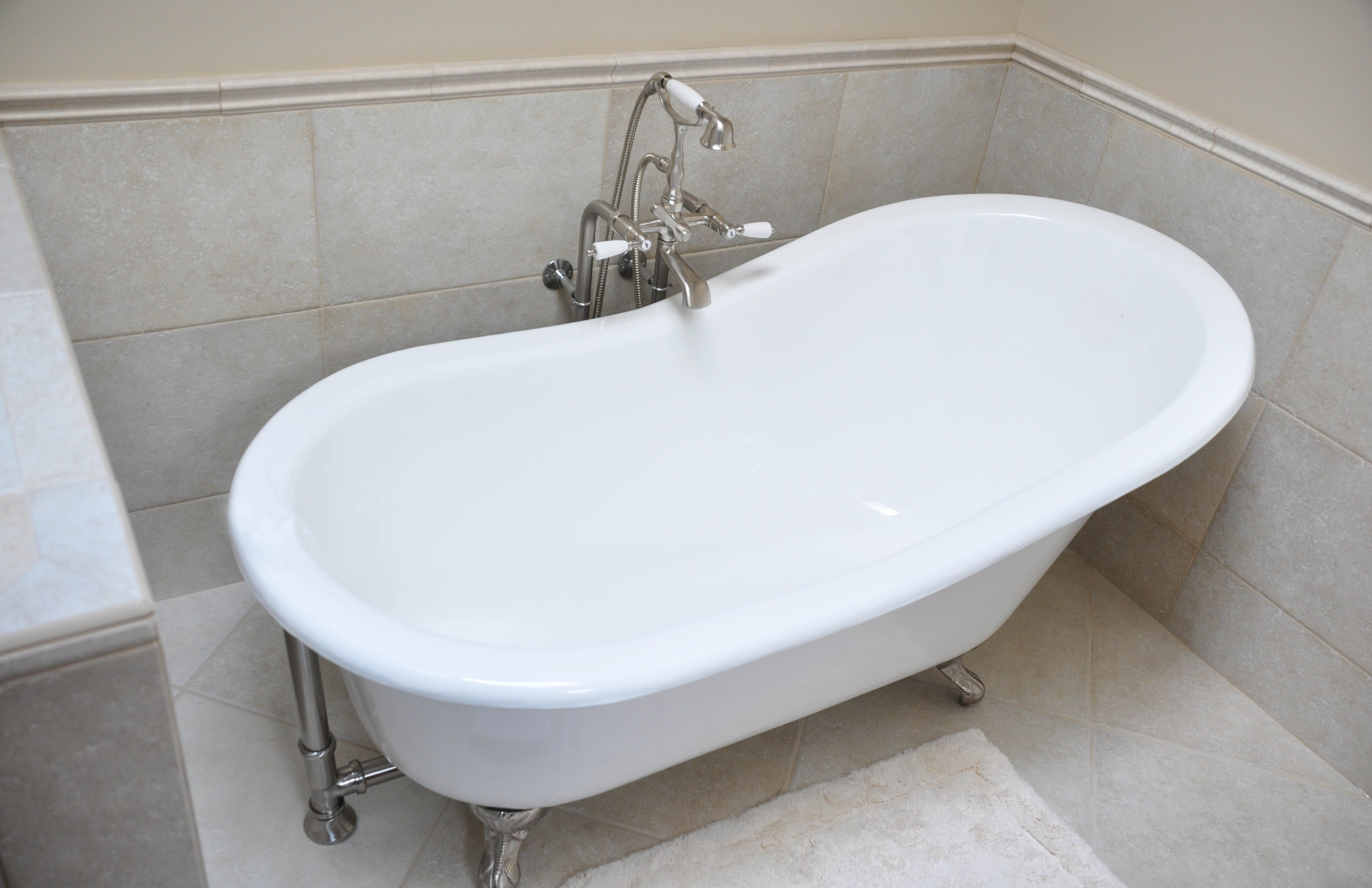 Classic cast iron slipper tub with brushed nickel claw feet, glazed ...