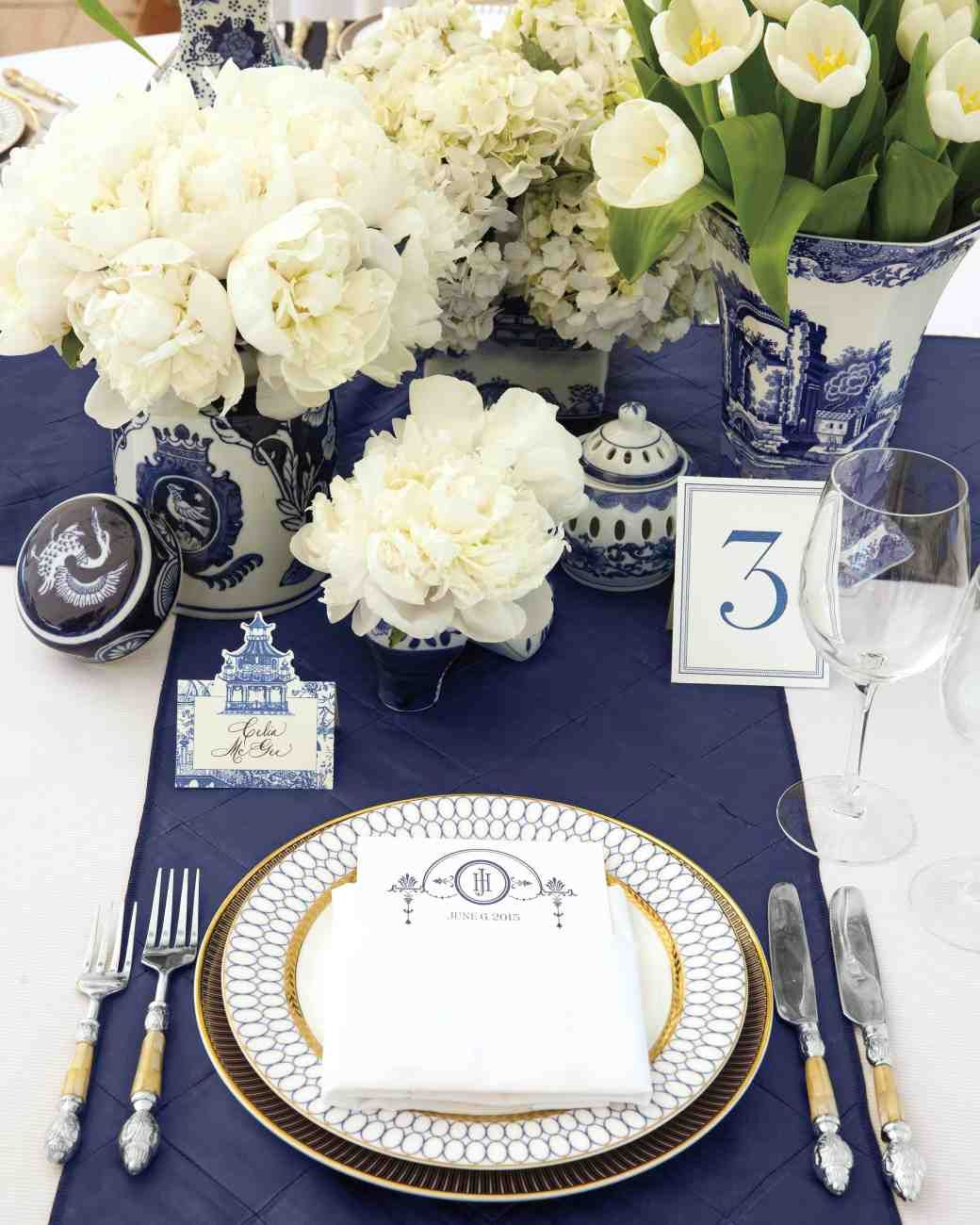 This Blue-and-White Wedding in Connecticut Was Inspired by a China Pattern | Martha Stewart Weddings - The five-tier Tahitian vanilla cake by Ana Parzych Cakes, inspired by the couple's favorite dessert from the Icebox Cafe in Miami Beach, was filled with vanilla and lemon mousseline over raspberry preserves, then covered in vanilla meringue buttercream and Swiss-rolled fondant hand-painted with scenery from Winvian and the surrounding area.