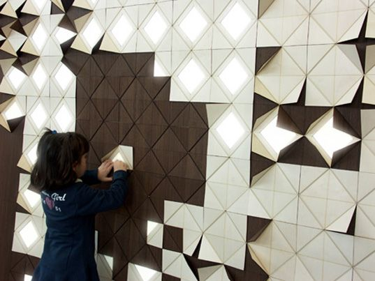 light form: gorgeous wood wall panels flip up to reveal light