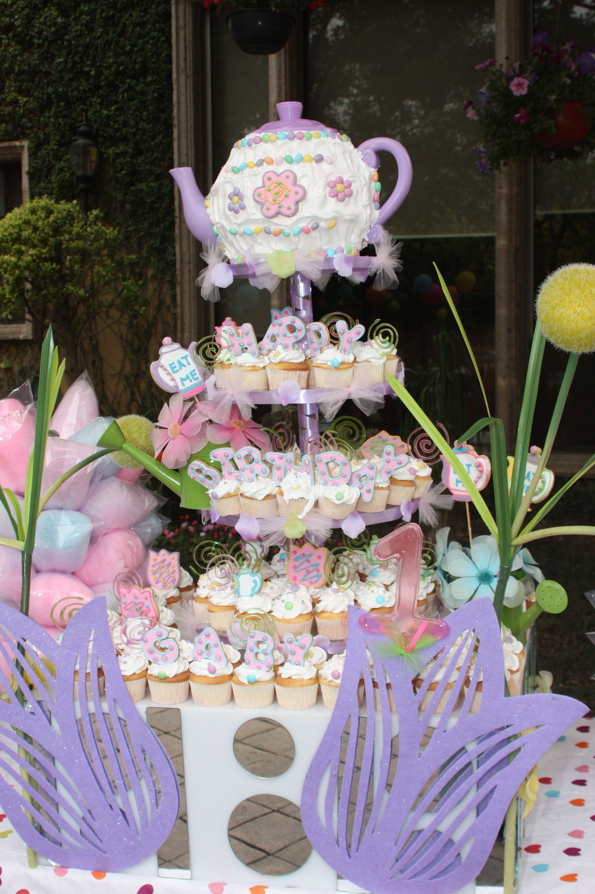 Alice in wonderland tea party cakewhats her theme this
