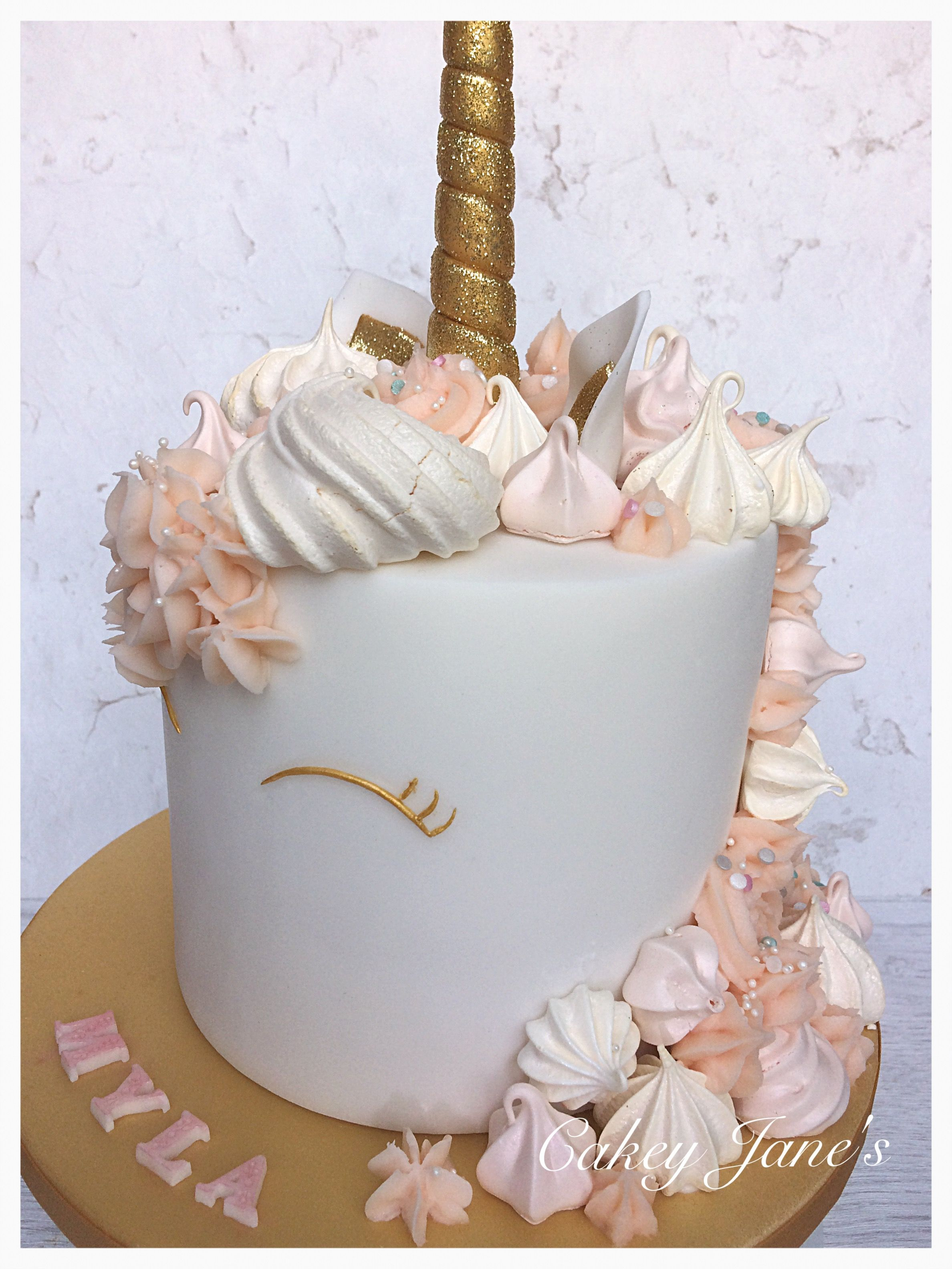 Unicorn 4 Layer Cake With Meringue Kisses And Ercream Swirls