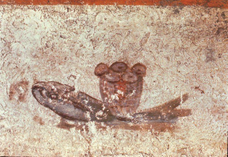 Detalle del fresco. Anónimo. Símbolos eucarísticos del pan y el pez. Cripta de Lucina en las Catacumbas de Calixto. Roma, Italia.