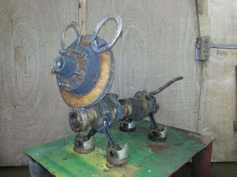 Dog made from scrap metal and old engine parts. Welding