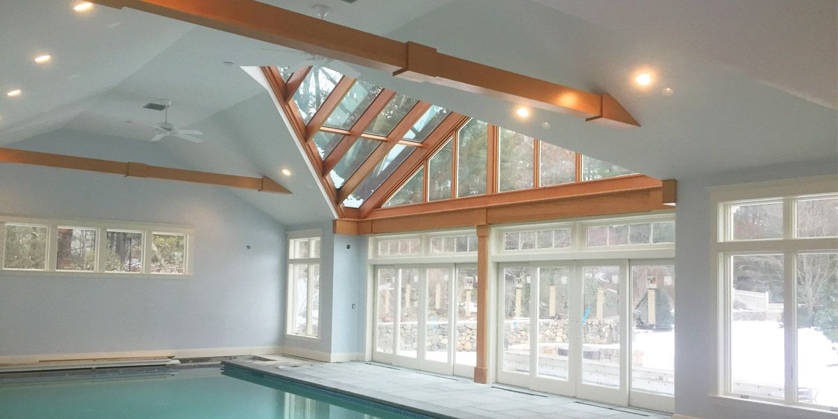 A magnificent indoor swimming pool enclosure with elegant ...