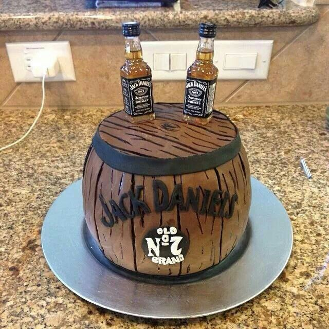 Jack Daniels cake barrel placed on an oversized board with