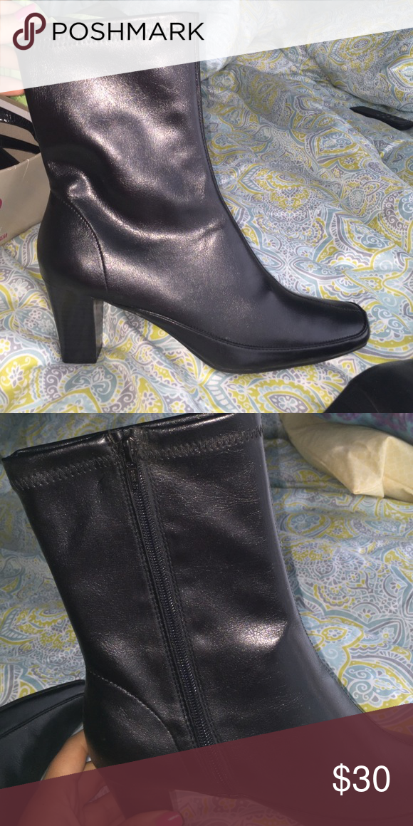 NWOT Black leather heel boots Black leather zip up boots with heel. Size 9 Shoes Heeled Boots