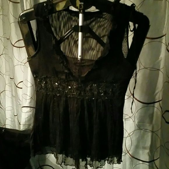 Sandrea brand black sheer top Black sleeveless sheer top with sequins and beading embellishments at waist ... adorable for summer . Sandrea Tops Tank Tops