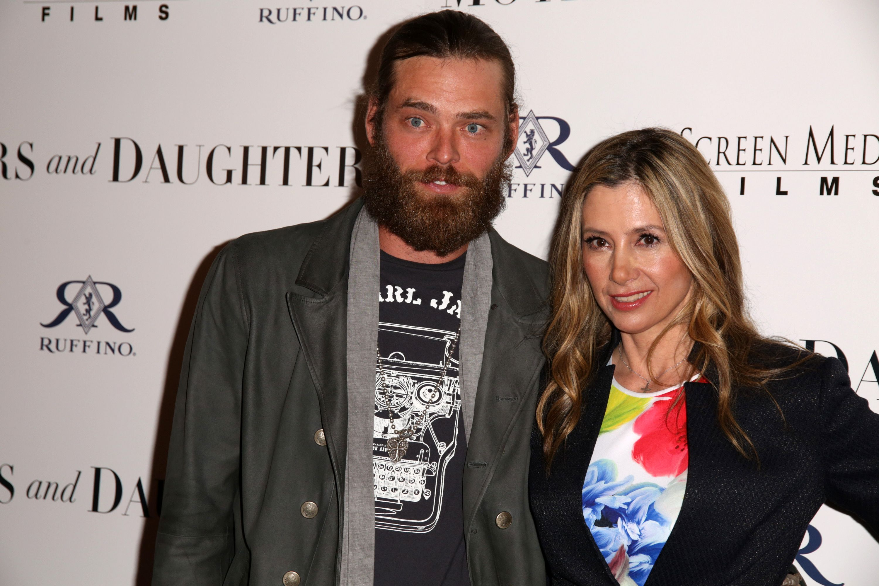 Christopher Backus and  Mira Sorvino attend the premiere of 'Mothers and Daughters' at The London on April 28, 2016 in West Hollywood, California.