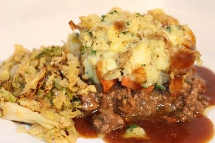 Braised Mince, rich gravy, vegetables and a crushed potato topping.