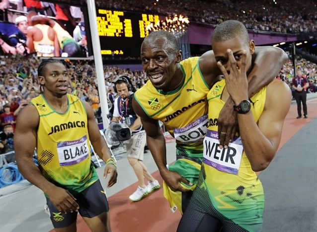 Jamaica's Usain Bolt, Yohan Blake and Warren Weir celebrate their medals in the men's 200m final in the Olympic Stadium