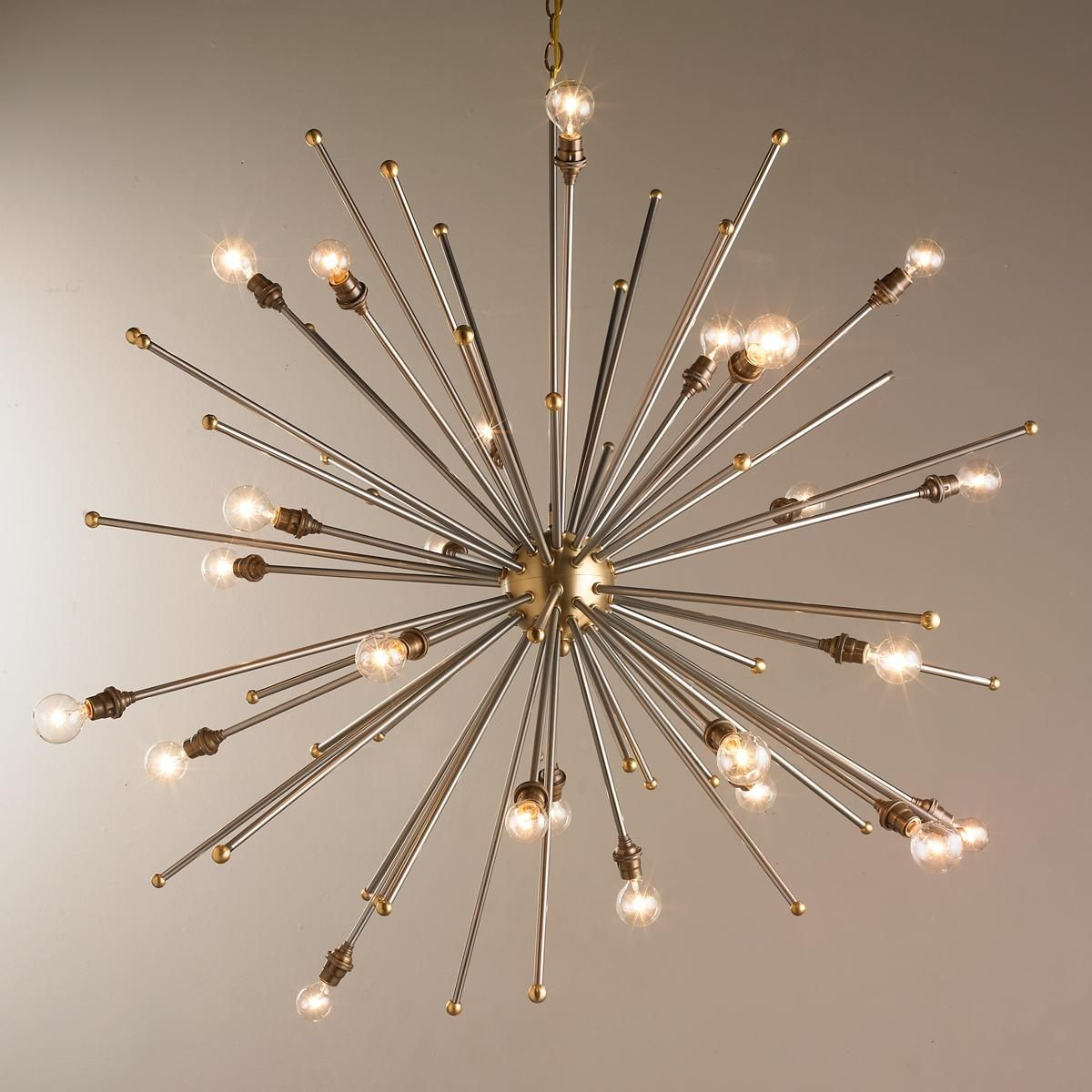 Mixed metals sputnik chandelier steel and brass combine to create mixed metals sputnik chandelier steel and brass combine to create this stunning well executed sputnik chandelier the antique brass sockets against the mozeypictures Images