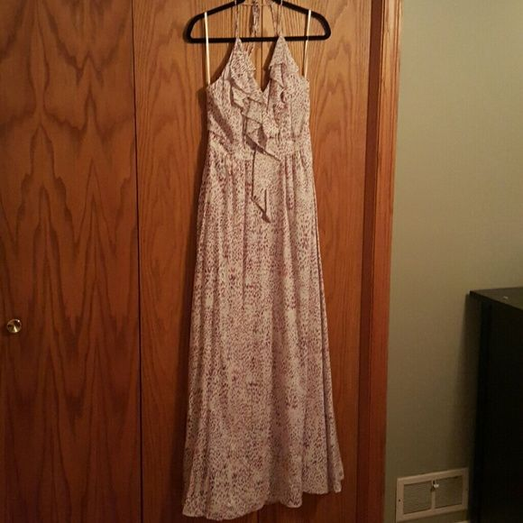 BCBGENERATION Maxi Dress Size 10 NWT Beautiful maxi dress with purple and red accents. Delicate straps, low back, and pockets make this an amazing dress. New with tags! BCBGeneration Dresses Maxi