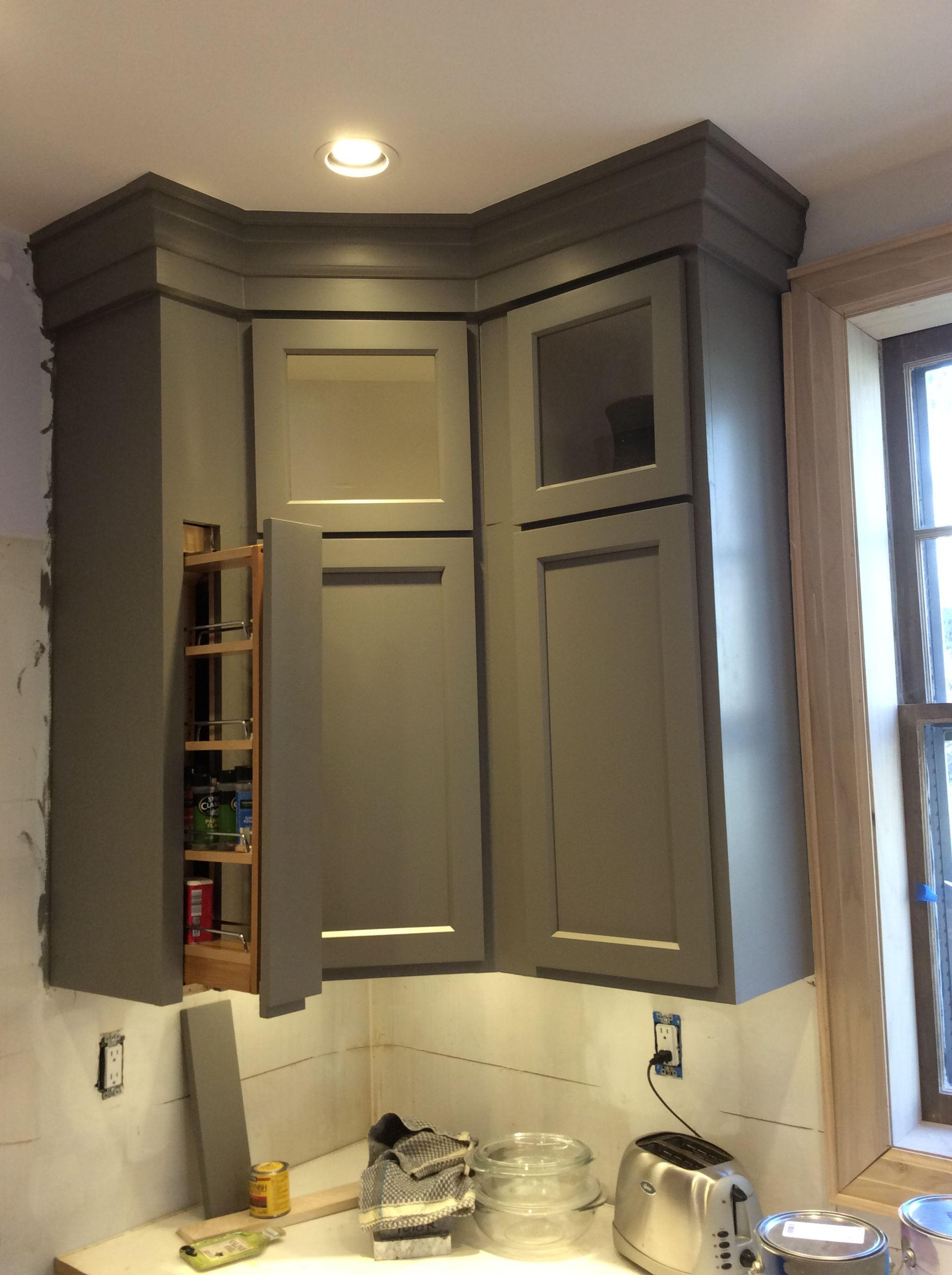 Chelsea Gray glass topped kitchen cabinets with spice rack ...