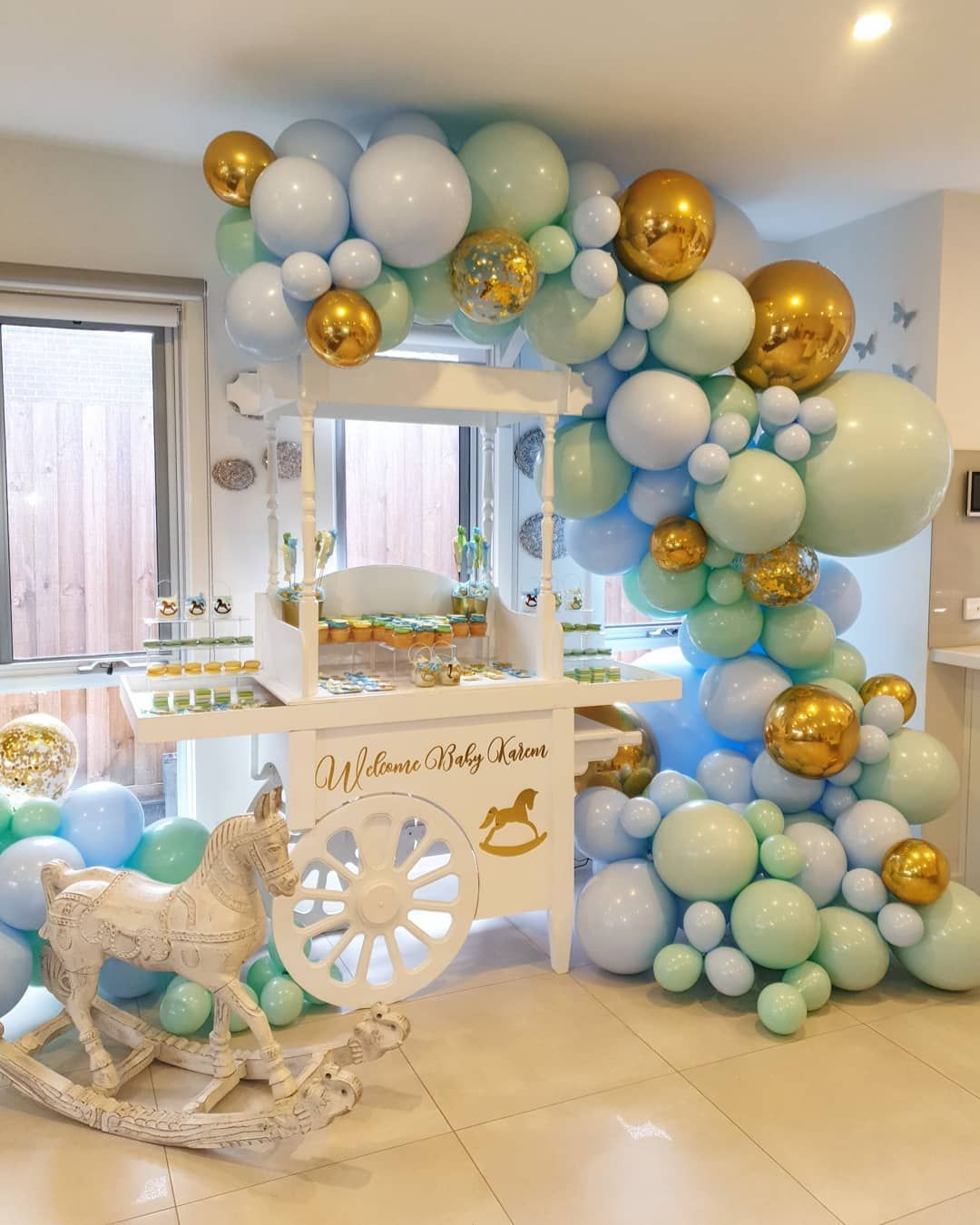 Baby Boys Baby Shower Ideas Look At This Amazing Balloon Garland And Set Up Candy Cart Welcome Bab Pastel Balloons Balloon Garland Baby Shower Decorations