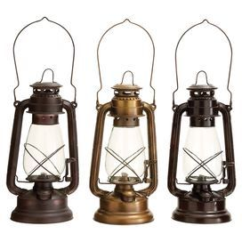 """Rustic metal lantern a fuel storage tank and top handle.   Product: Set of 3 lanternsConstruction Material: Metal and glassColor: Bronze and copperDimensions: 13"""" H x 6"""" DiameterNote: Fuel not included"""